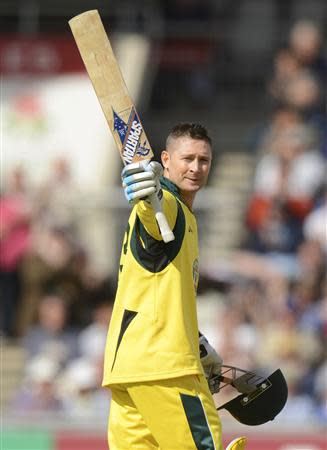 Australia's Clarke waves his bat after completing his century during the second one-day international against England at Old Trafford cricket ground in Manchester