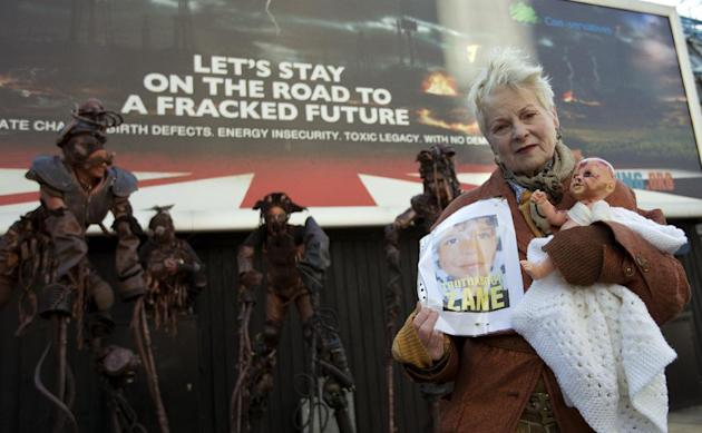 British fashion designer and environmental campaigner Vivienne Westwood poses for the media with street performers as she launches a poster campaign against the use of fracking operations in Britain t