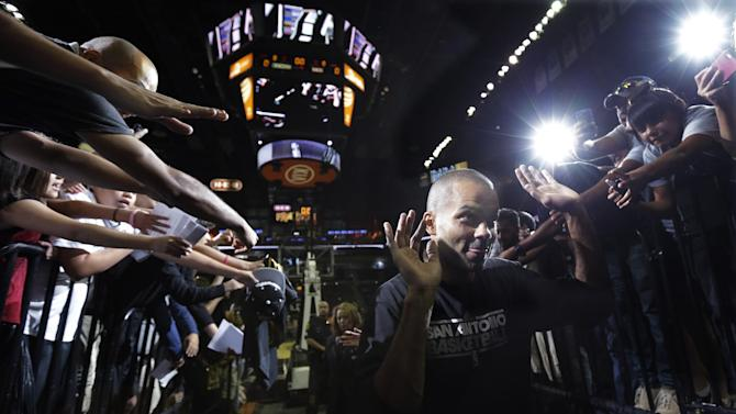 San Antonio Spurs' Tony Parker, of France, walks off the court following an open NBA basketball practice, Sunday, Oct. 6, 2013, in San Antonio
