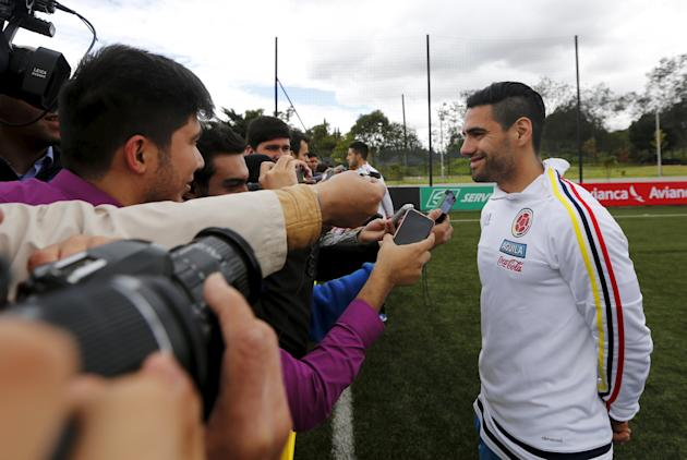 Colombian soccer player Falcao smiles during a news conference in Bogota