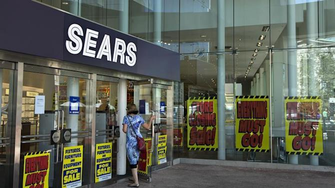 A customer enters the closing down Sears store is shown in downtown Vancouver
