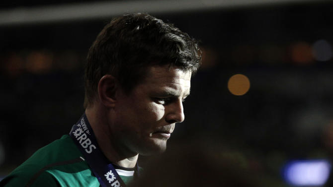 Ireland's Brian O'Driscoll leaves the pitch after defeating France and winning the Six Nations Rugby Union tournament at the Stade de France stadium, in Saint Denis, outside Paris, Saturday, March 15, 2014. (AP Photo/Christophe Ena)
