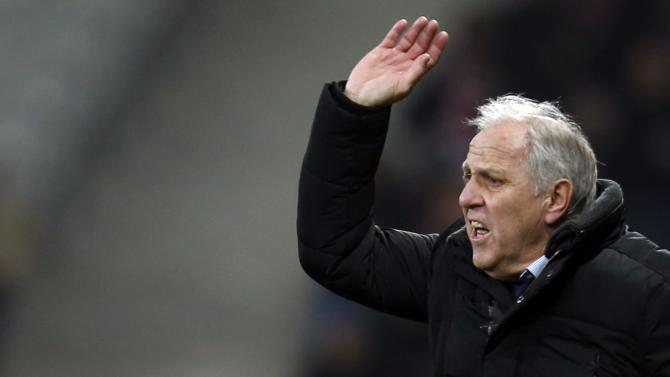 Lille's coach Rene Girard reacts during their French Ligue 1 soccer match against Reims' at Pierre Mauroy Stadium in Villeneuve d'Ascq