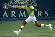 """Rageev Ram returns a shot to Sam Querrey during their Los Angeles Open semi-final match on July 28. """"It was a tough match, he's a serve-and volley guy and knows how to use his slice. I managed to win by serving well to recover the break,"""" Querrey said of Ram"""