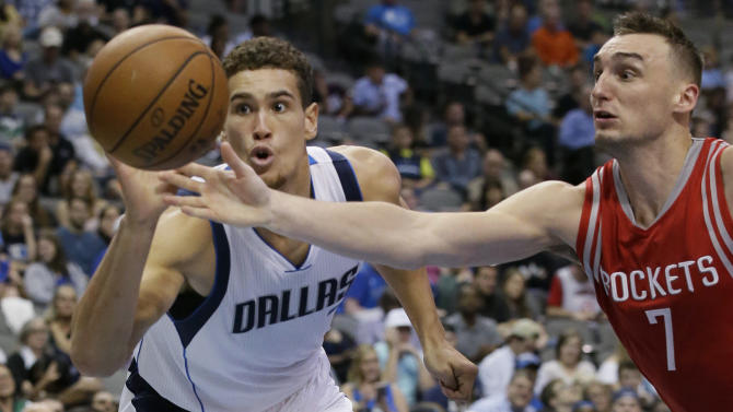 Houston Rockets forward Sam Dekker, right, and Dallas Mavericks forward Dwight Powell chase the ball during the second half of an NBA preseason basketball game Wednesday, Oct. 19, 2016, in Dallas. (AP Photo/LM Otero)
