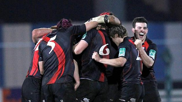 Edinburgh Rugby's Matt Scott (R) celebrates with teamates after their victory over Racing Metro 92 during their European Cup rugby union match at the Yves du Manoir Stadium in Colombes, northwest of Paris, on January 13, 2012. Edinburgh Rugby won 27-24