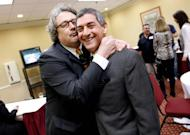 George Kennedy, right, media consultant for Louisiana Lieutenant Governor Jay Dardenne, poses for the camera at his election night watch party in Baton Rouge, La., Saturday, Oct. 22, 2011. Dardenne, who took office after a special election last year, faced off against Plaquemines Parish President Billy Nungesser on Saturday. Like Jindal, Nungesser was a vocal critic of the federal response to the massive Gulf oil spill. (AP Photo/Gerald Herbert)