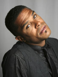 """FILE - In this Sept. 18, 2008 file photo, singer Maxwell poses for a portrait in New York. The soul crooner says his new album """"blackSUMMERS'night,"""" due out in 2012, will be a little more upbeat compared to his previous efforts. (AP Photo/Seth Wenig, File)"""