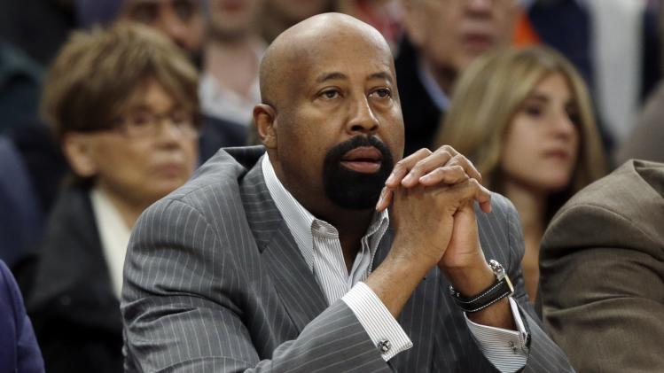 New York Knicks head coach Mike Woodson watches his team play during the first half of an NBA basketball game against the Toronto Raptors Wednesday, April 16, 2014, in New York