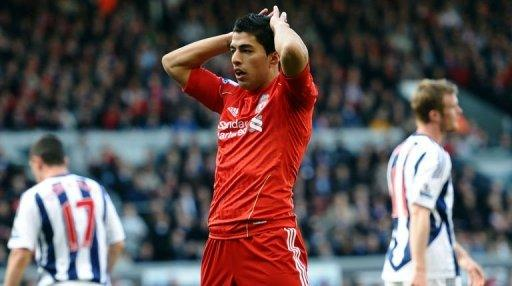 Liverpool's Luis Suarez reacts after missing an opportunity to score