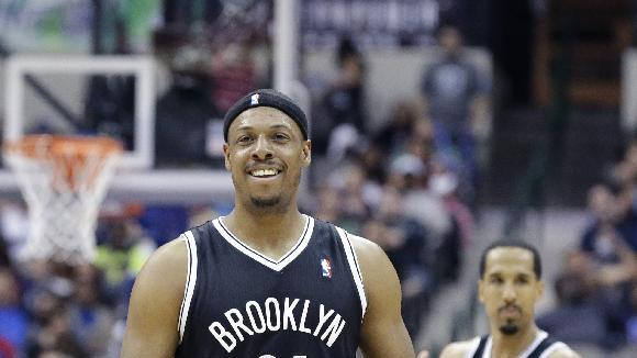 Brooklyn Nets forward Paul Pierce (34) smiles after a play with teammate Shaun Livingston (14) looking on during overtime in an NBA basketball game against the Dallas Mavericks Sunday, March 23, 2014, in Dallas. The Nets won 107-104 in overtime