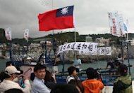 This file photo shows right wing Taiwanese activists flying a national flag and banners at a fishing harbor in Yehliou, Taipei county, in 2010, to protest against the Japanese government over disputed islands in the East China Sea, over which Taipei claims sovereignty