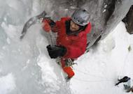 "In this Sunday, Feb. 6, 2017 photo, Darwin Castillo, of Washington, D.C., drives the pick of his axe into the ice while climbing ""Dracula,"" a 100-foot tall ice formation on Frankenstein Cliff in Hart's Location, N.H. (AP Photo/Robert F. Bukaty)"