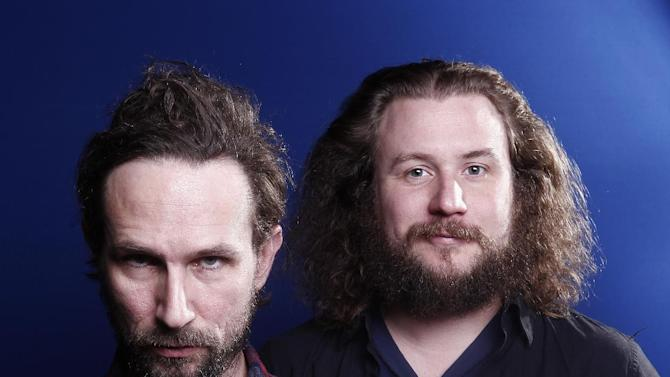 "In this March 15, 2012 photo, musicians Will Johnson, left, and Yim Yames of the group ""New Multitudes"" pose for a portrait  in New York. The group, which also includes Jay Farrar and Anders Parker, honors Woody Guthrie with new music based on his unfinished works. (AP Photo/Carlo Allegri)"