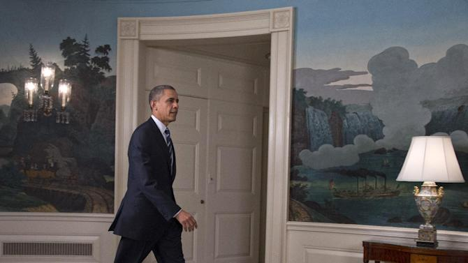 President Barack Obama arrives in the Diplomatic Room of the White House in Washington, Tuesday, Aug. 28, 2012, to talk about Tropical Storm Isaac. (AP Photo/Carolyn Kaster)