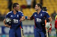 England's Alex Hales (right) celebrates the win with team mate Michael Lumb during the International Twenty20 match between New Zealand and England played at the Westpac Stadium in Wellington on February 15, 2013. England defeated New Zealand by 10 wickets in the Twenty20 international decider in Wellington on Friday after a batting masterclass from openers Lumb and Hales