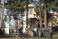 """Afghan investigators inspect the site of a suicide bomb attack in Herat province. At least 19 people including 10 policemen were killed and 39 wounded in three suicide attacks in Afghanistan Tuesday, officials said, as spring heralded the """"fighting season"""""""