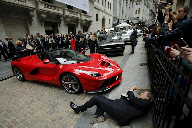 File photo of a Ferrari LaFerrari sports car parked at the entrance of the New York Stock Exchange in New York