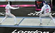 China's Cao Zhongrong (L) competes against Czech Republic's David Svoboda in fencing epee part of the modern pentathlon at the London 2012 Olympic Games. Svoboda won gold and Cao silver