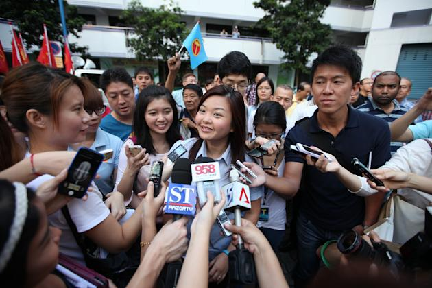 WP's Lee Li Lian speaking to reporters at the thank you parade.