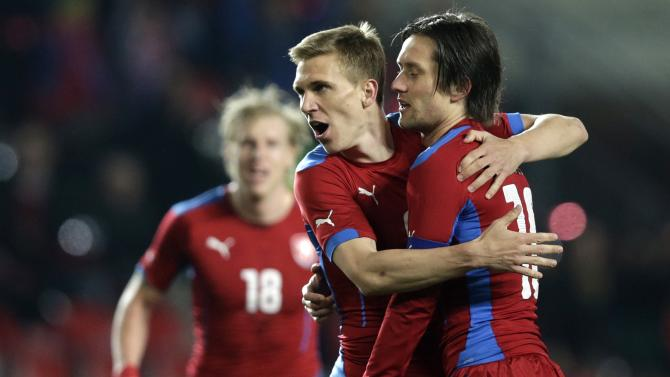 Czech Rosicky is congratulated by his team mates Dockal and Rajtoral after scoring against Norway during their international friendly soccer match in Prague