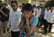 An unidentified relative of one of the convicted Hindus breaks down upon hearing the verdict at the district court in Mehsana, about 40 kilometers (25 miles) north of Ahmadabad, India, Wednesday, Nov. 9, 2011. The court convicted 31 Hindus for killing dozens of Muslims by setting a building on fire in Gujurat state during one of India's worst rounds of communal violence nine years ago. (AP Photo/Ajit Solanki)