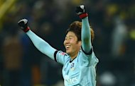 Hamburg's Korean striker Son Heung-Min celebrates at the end of the German first division Bundesliga football match against Borussia Dortmund in Dortmund on February 9, 2013. Defending champions Borussia Dortmund suffered a shock 4-1 defeat at home to Hamburg in the Bundesliga on Saturday with Son claiming two goals as both teams finished with 10 men