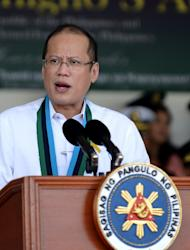 "Philippine President Benigno Aquino gives a speech during the 77th anniversary celebration of the Armed Forces of the Philippines at the Camp Aguinaldo in Manila, on December 21, 2012. Aquino has approved a landmark law that criminalises ""enforced disappearances"", a presidential spokeswoman said on Saturday, in a move hailed by human rights groups"