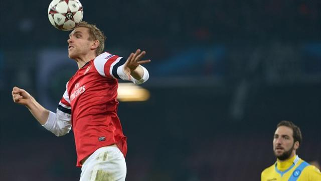 Champions League - Mertesacker pleased to progress