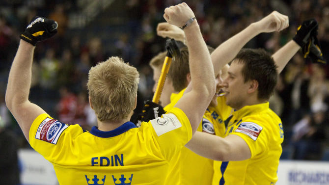 Skip Niklas Edin (L) celebrates Sweden's 7-6 win over Norway in the bronze medal match at the Ford World Men's Curling Championships in Regina, Saskatchewan, April 10, 2011.  AFP PHOTO / Geoff Robins (Photo credit should read GEOFF ROBINS/AFP/Getty Images)