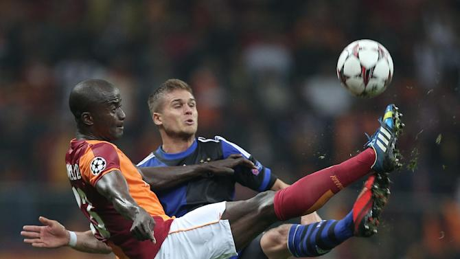Galatasaray's Dany Nounkeu, front, and Rurik Gislason of FC Copenhagen fight for the ball during their Champions League Group B soccer match in Istanbul, Turkey, Wednesday, Oct. 23, 2013. (AP Photo)