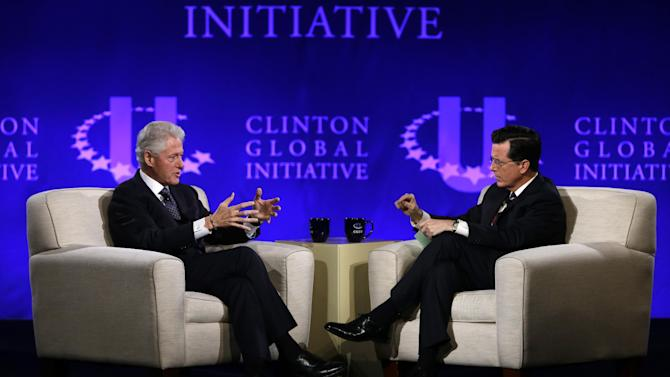 """FILE - This April 6, 2013 file photo shows former President Bill Clinton, left, and Comedy Central's Stephen Colbert during the Clinton Global Initiative at Washington University in St. Louis. More than 1,000 students from 75 countries and all 50 states are gathered for a weekend of sessions seeking practical and innovative solutions to the world's problems. Colbert lured the former president to the social networking site on """"The Colbert Report"""" on Monday, signing him up with the handle PrezBillyJeff. Clinton dictated his first message to Colbert, who typed: """"Just spent an amazing time with Colbert! Is he sane? He is cool!""""  Whether Clinton would continue to use the account remained uncertain. Colbert's hand is clearly in the account's description, too. It reads: """"Stephen Colbert is my BFF.""""  By Tuesday morning, the account had quickly amassed nearly 50,000 followers and was climbing fast.  (AP Photo/Jeff Roberson, file)"""
