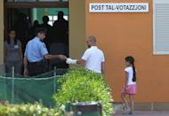 Voters go to cast their vote in Valetta, Malta, on May 28, in a referendum on divorce. Overwhelmingly Catholic Malta has voted to legalise divorce, Prime Minister Lawrence Gonzi has announced, after votes were counted following a non-binding referendum the day before