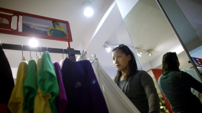 In this Tuesday, Feb. 21, 2013 photo, Nepalese climber Pema Dikki looks at climbing gear at a store in Katmandu, Nepal. Aiming to change the all-male image of mountaineering in the country, a group of Nepalese women have embarked on a mission to climb the tallest mountain on each of the seven continents. The women, aged between 21 and 32, have already climbed Everest in Asia, Kosciuszko in Australia and Elbrus in Europe and are preparing next week to climb Mount Kilimanjaro in Africa to mark International Women's Day. (AP Photo/Niranjan Shrestha)