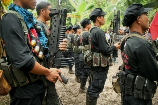 This file photo, taken in 2008, shows members of the communist rebel New People's Army standing in formation during a ceremony at a remote camp in Davao, on southern Philippine island of Mindanao. The military said on Monday communist rebels killed four unarmed soldiers in an ambush, further hurting efforts to revive stalled talks aimed at ending one of Asia's longest-running rebellions