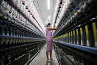 A labourer is seen working in a textile factory in Huaibei, on July 24, 2013. New figures suggest the manufacturing sector has started to stabilise
