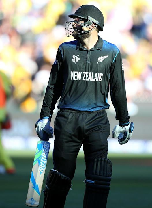 New Zealand's Dan Vettori leaves the field after he was bowled out for nine runs while batting against Australia during the Cricket World Cup final in Melbourne, Australia, Sunday, March 29, 2015. (AP
