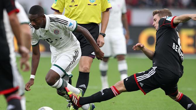 Leverkusen's Lars Bender, right, and Bayern's David Alaba of Austria challenge for the ball during the German first division Bundesliga soccer match between Bayer Leverkusen and Bayern Munich in Leverkusen, Germany, Saturday, Oct. 5, 2013