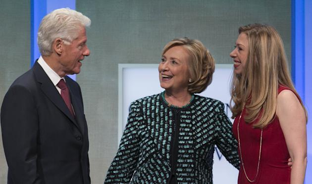 Former U.S. Secretary of State and former first lady Hillary Clinton and daughter Chelsea chat with former U.S. President Clinton at the Clinton Global Initiative 2013 in New York