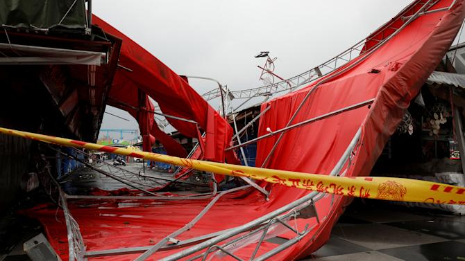 A damaged tent blown over by strong winds from Typhoon Megi in Hualien, eastern Taiwan