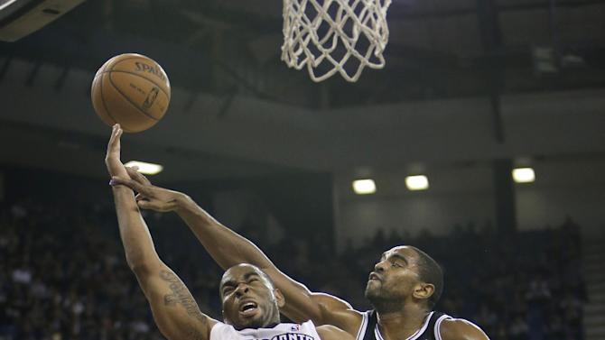 Sacramento Kings guard Marcus Thornton, left, drives to the basket against Brooklyn Nets guard Alan Anderson during the fourth quarter of an NBA basketball game in Sacramento, Calif., Wednesday, Nov. 13, 2013. The Kings won 107-86