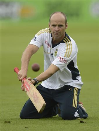 South Africa's coach Gary Kirsten hits a ball during a training session before Thursday's first cricket test match against England at the Oval cricket ground in London July 18, 2012. REUTERS/Philip Br