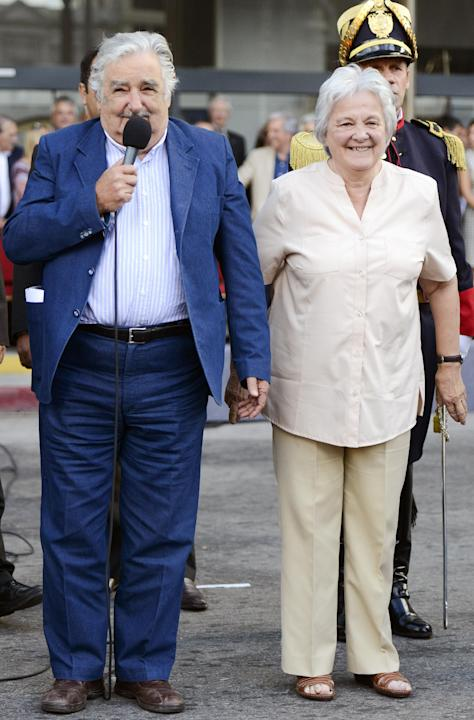 Uruguay's President Jose Mujica, left, and his wife Lucia Topolansky attend a flag ceremony in Montevideo, Uruguay, Friday, Feb. 27, 2015. On Sunday, Mujica will hand over the presidency to former