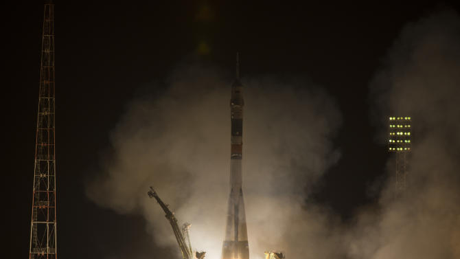 In this photo provided by NASA, the Soyuz-FG rocket booster with Soyuz TMA-08M space ship carrying a new crew to the International Space Station, ISS, blasts off at the Russian leased Baikonur cosmodrome, Kazakhstan, Friday, March 29, 2013. The Russian rocket is carrying Russian cosmonauts Alexander Misurkin, Pavel Vinogradov and U.S. astronaut Christopher Cassidy. (AP Photo/NASA, Carla Cioffi)