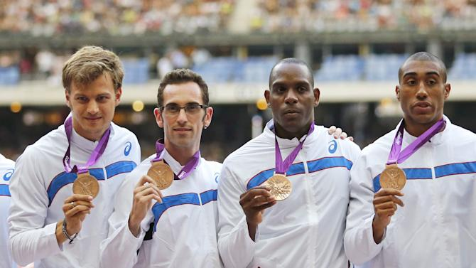 Members of France's relay team pose during a medal ceremony as part of the IAAF Diamond League athletics meeting at the Stade de France Stadium in Saint-Denis