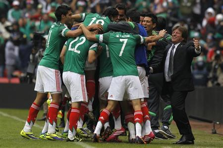 Mexico's coach Herrera celebrates a goal with his players during their 2014 World Cup qualifying playoff first leg soccer match against New Zealand at Azteca stadium in Mexico City