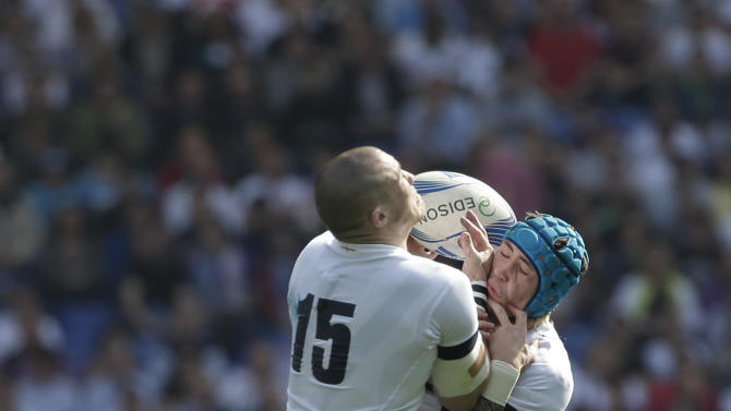 England's Mike Brown, left, and his teammate Jack Nowell reach for the ball during a Six Nations rugby union international match between Italy and England, in Rome, Saturday, March 15, 2014. (AP Photo/Alessandra Tarantino)
