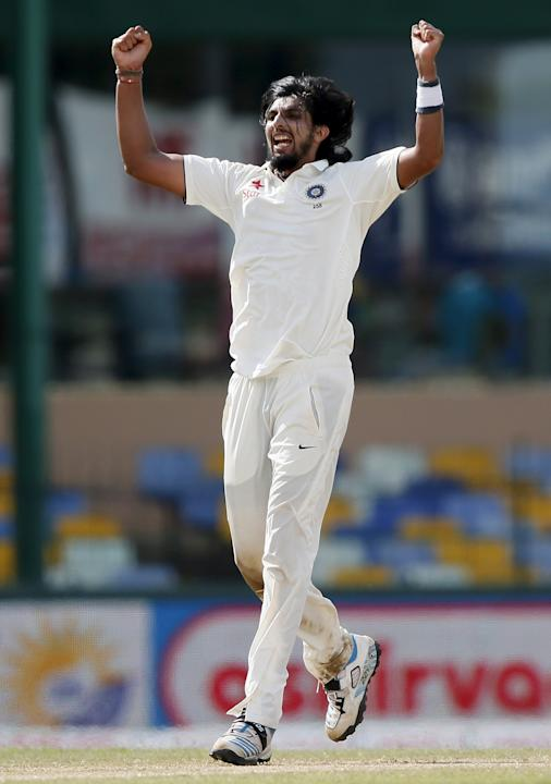 India's Ishant Sharma celebrates after taking the wicket of Sri Lanka's Rangana Herath during the third day of their third and final test cricket match in Colombo