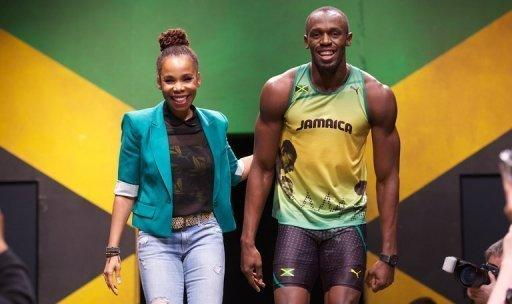 Jamaican designer Cedella Marley (L) and Jamaican sprinter Usain Bolt present Jamaican clothing for the 2012 Olympics