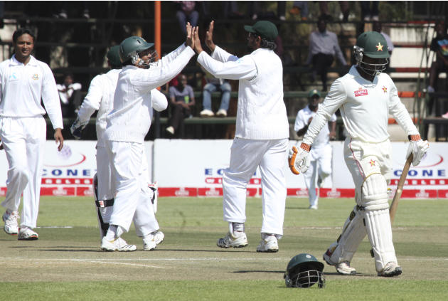 Bangladesh players celebrate the wicket of Zimbabwe's batsman Tatenda Taibu, right, on the second day of Zimbabwe's return to test cricket against Bangladesh in Harare, Friday, Aug. 5, 2011. Z